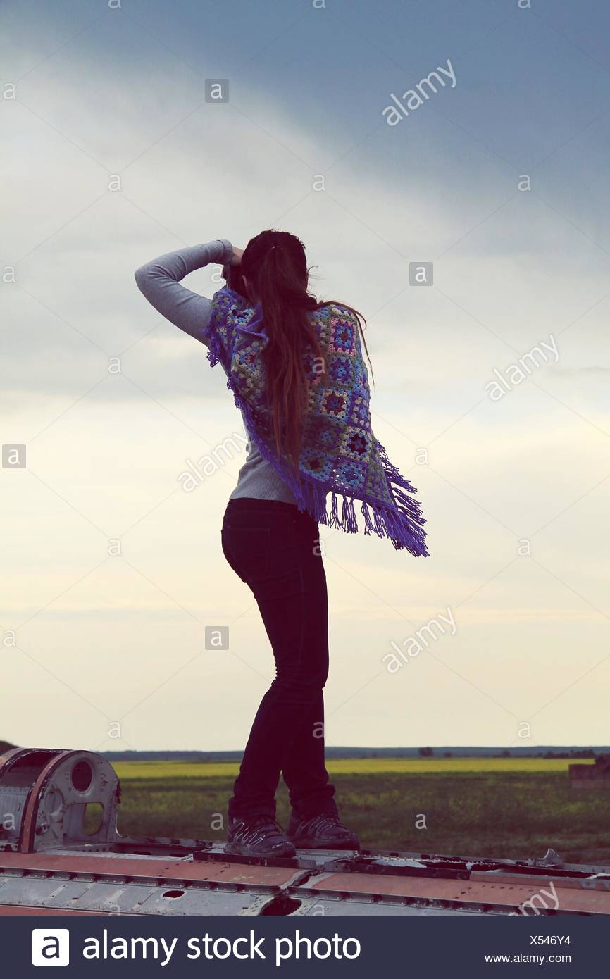 Full Length Of Woman Capturing Photo Against Sky - Stock Image