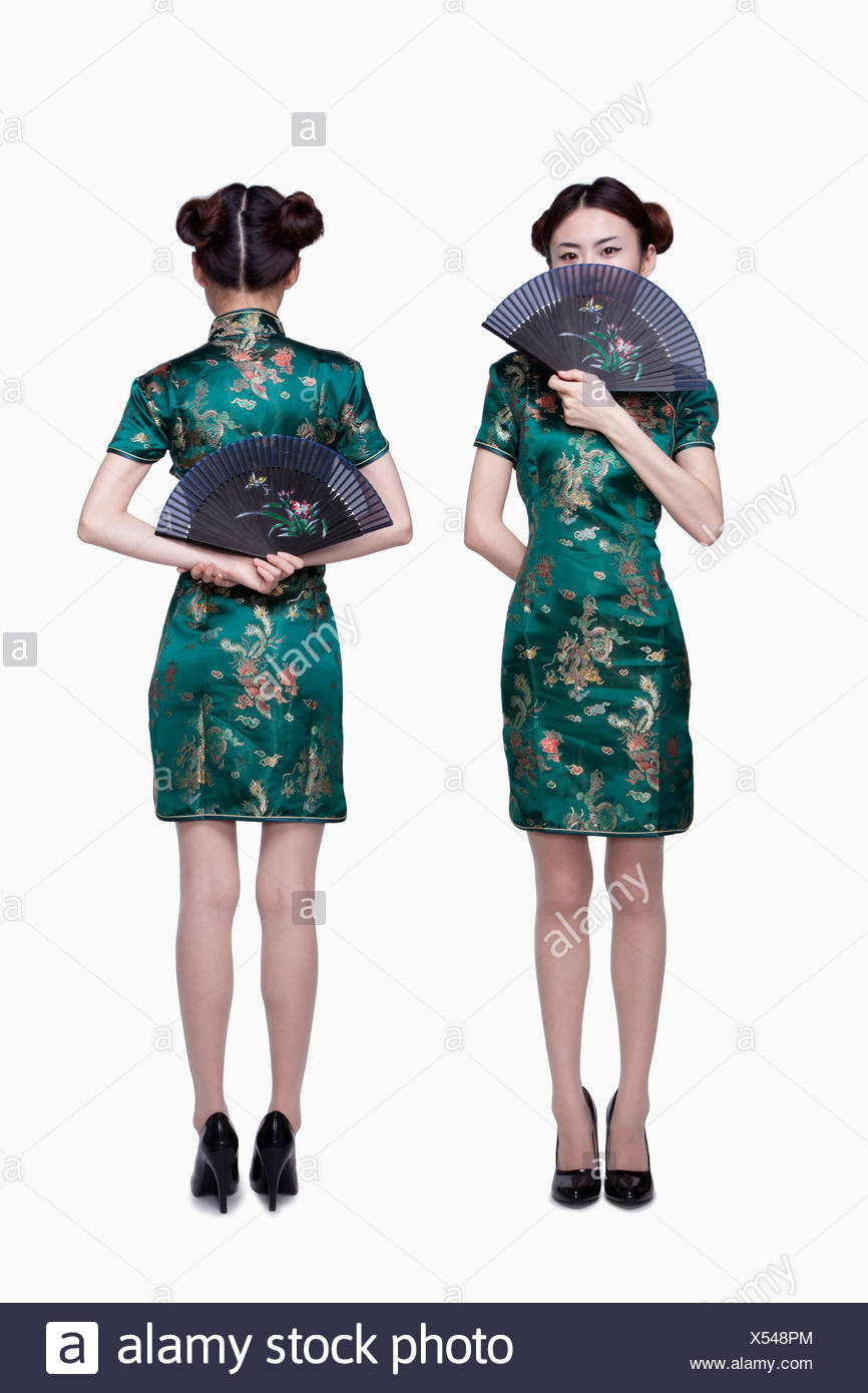 Woman in traditional clothing, front and back - Stock Image