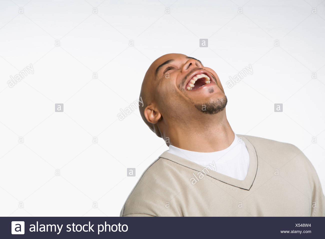Man laughing with head thrown back Stock Photo