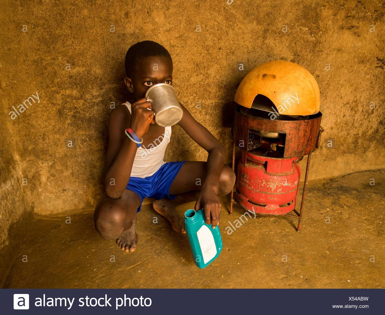A boy drinking some water. - Stock Image