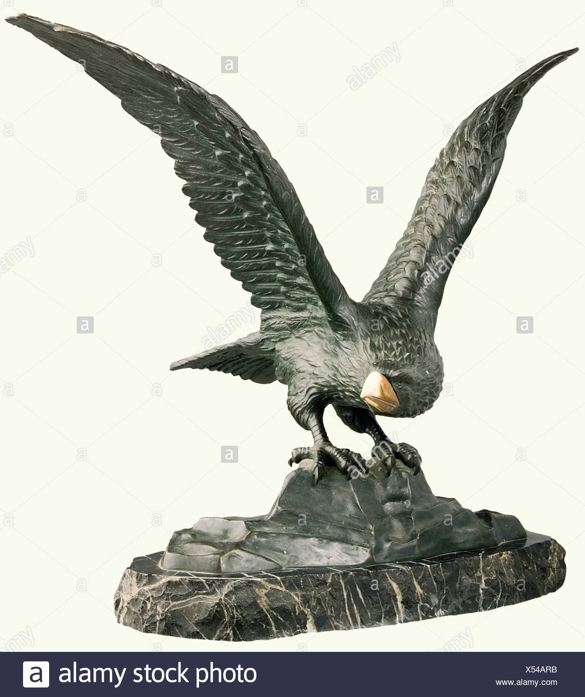 Rising eagle, a bronze figure, German, 19th century. With an inset ivory beak. The eagle is shown seated on a cliff, spreading its wings. Irregular shaped black marble plinth signed on one side 'R. Koch'. Height 44 cm. fine arts, 19th century, fine arts, art, statuette, figurine, figurines, statuettes, sculpture, sculptures, object, objects, stills, clipping, clippings, cut out, cut-out, cut-outs, Artist's Copyright has not to be cleared - Stock Image