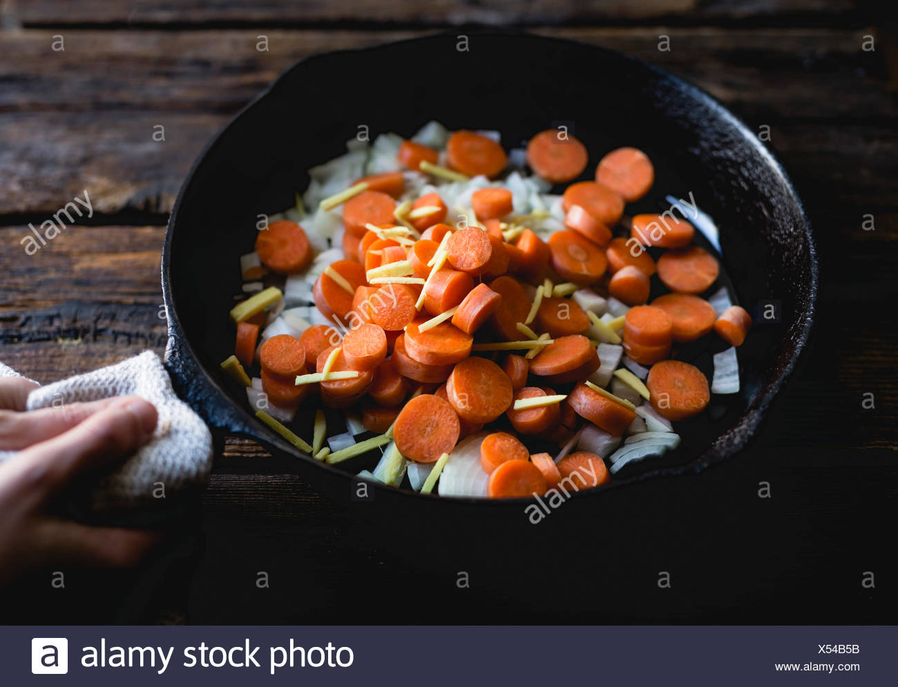 Carrots, onions and ginger in a saucepan - Stock Image
