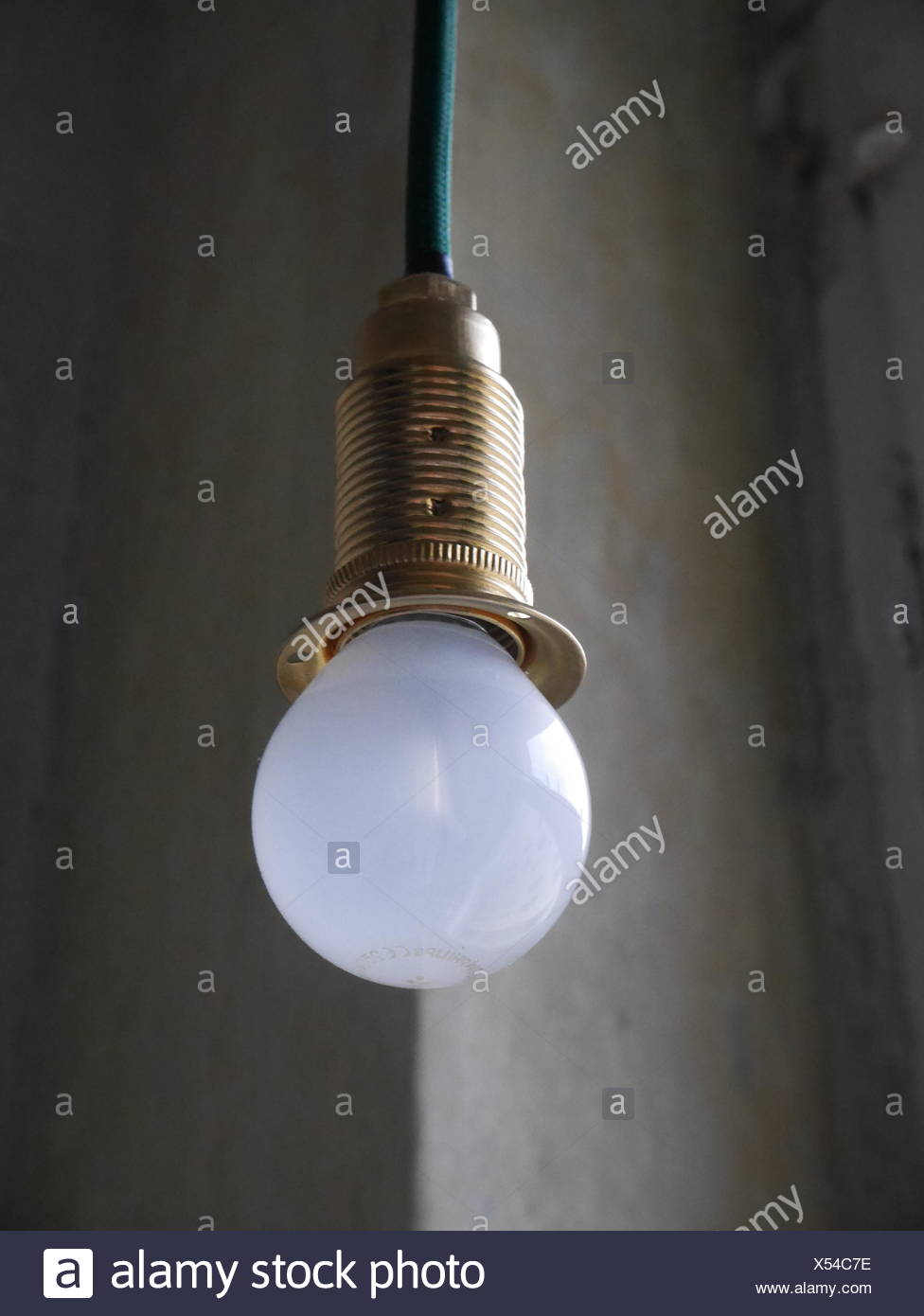 White light bulb hanging from ceiling ceiling stock photos white low angle view of white light bulb hanging from ceiling stock image aloadofball Gallery