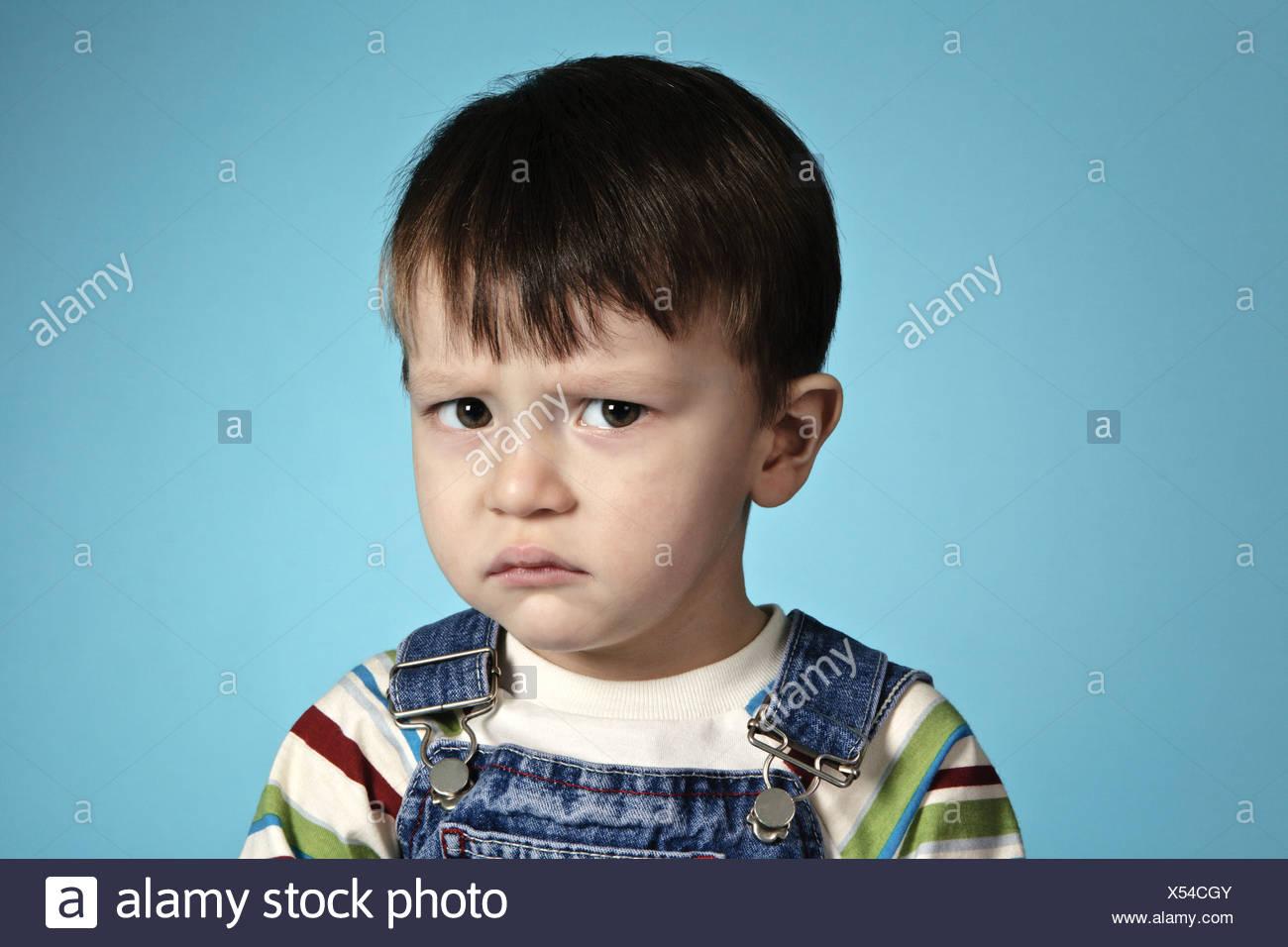 Stress boy with sad sight - Stock Image