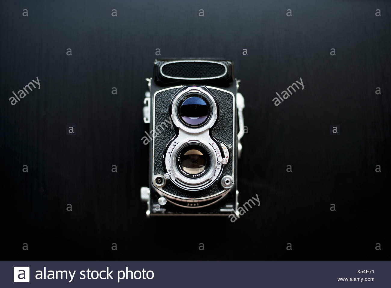 Retro styled camera over black background - Stock Image