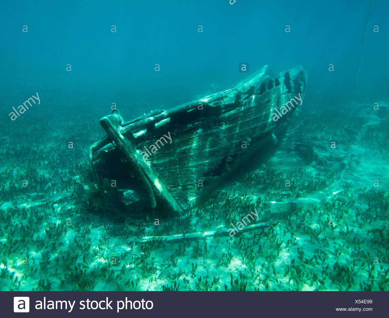 View of an abandoned sunken boat in water - Stock Image