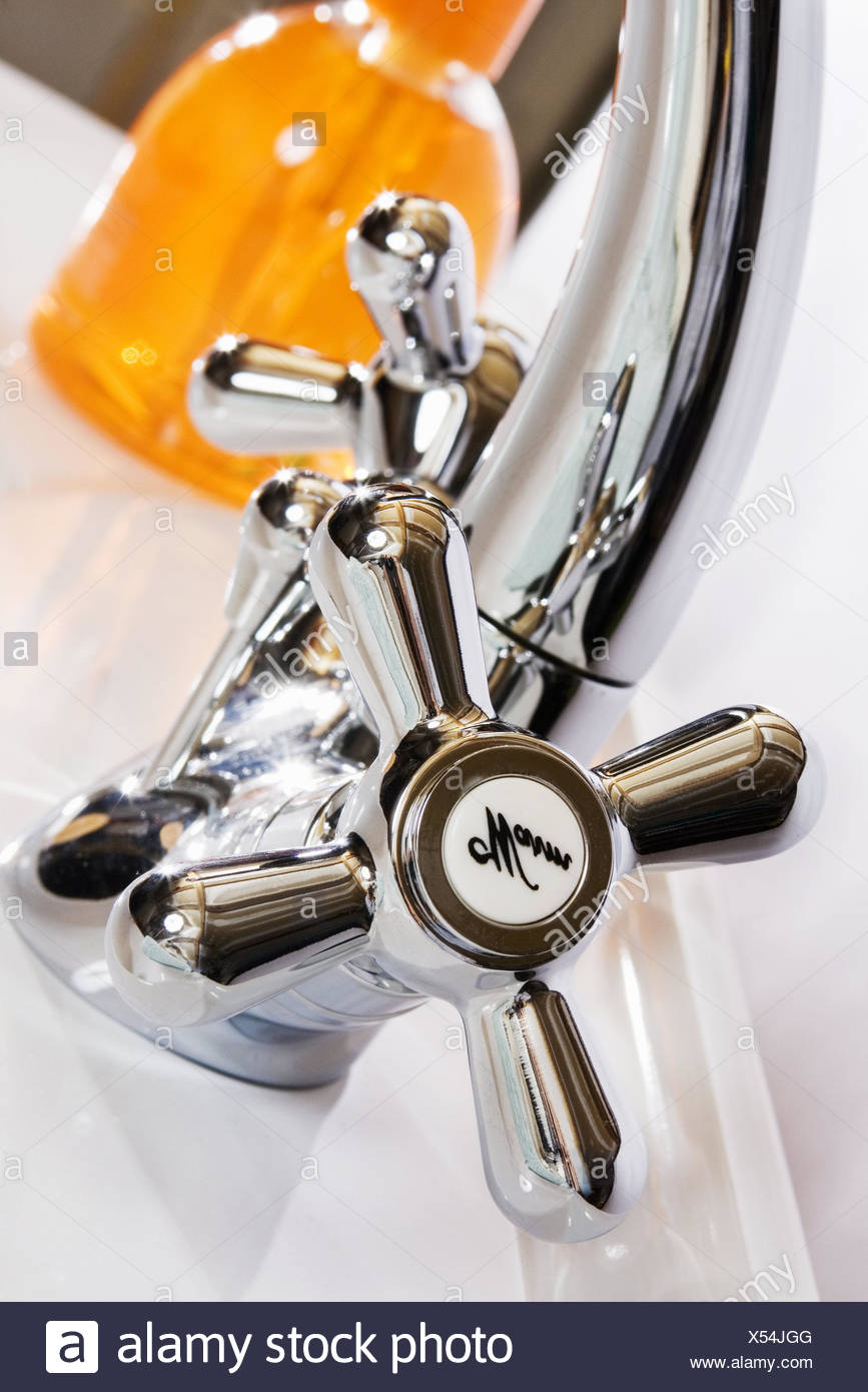 Bath, sink, tap, warmly, soap dispenser, medium close-up, bathroom, hand sink, bath armatures, sink armature, armature, mixer tap, valve, knob, twig reef armatures, chrome plated, chrome, personal care, beauty care, care, hygiene, brilliantly, body hygiene, hot water, cleanliness, cleanness, clean, wash, open up, turn off, liquid soap, nobody, nostalgically, design, metal, background blur, inside, - Stock Image