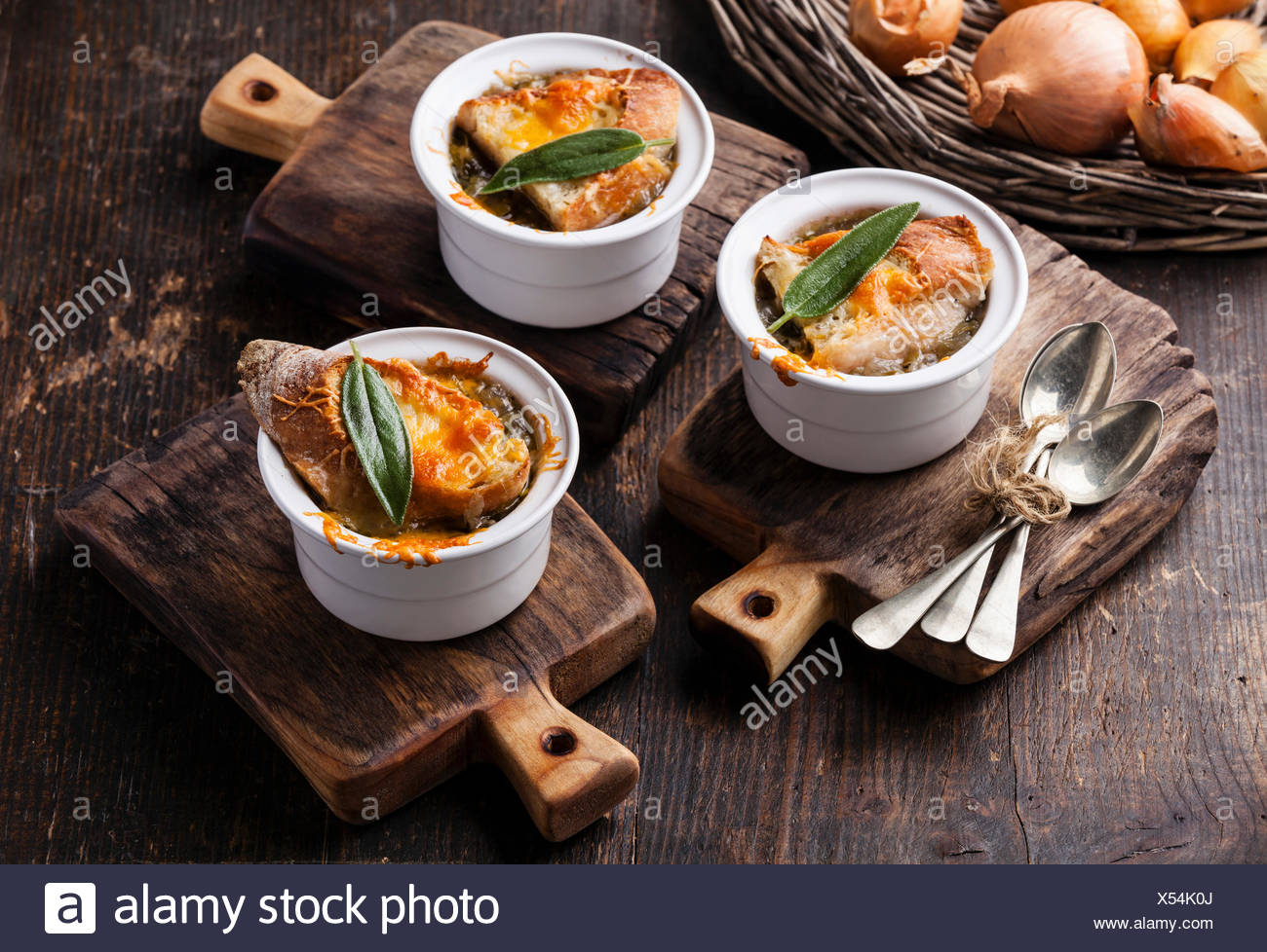 Onion soup with dried bread, sage and cheddar cheese - Stock Image