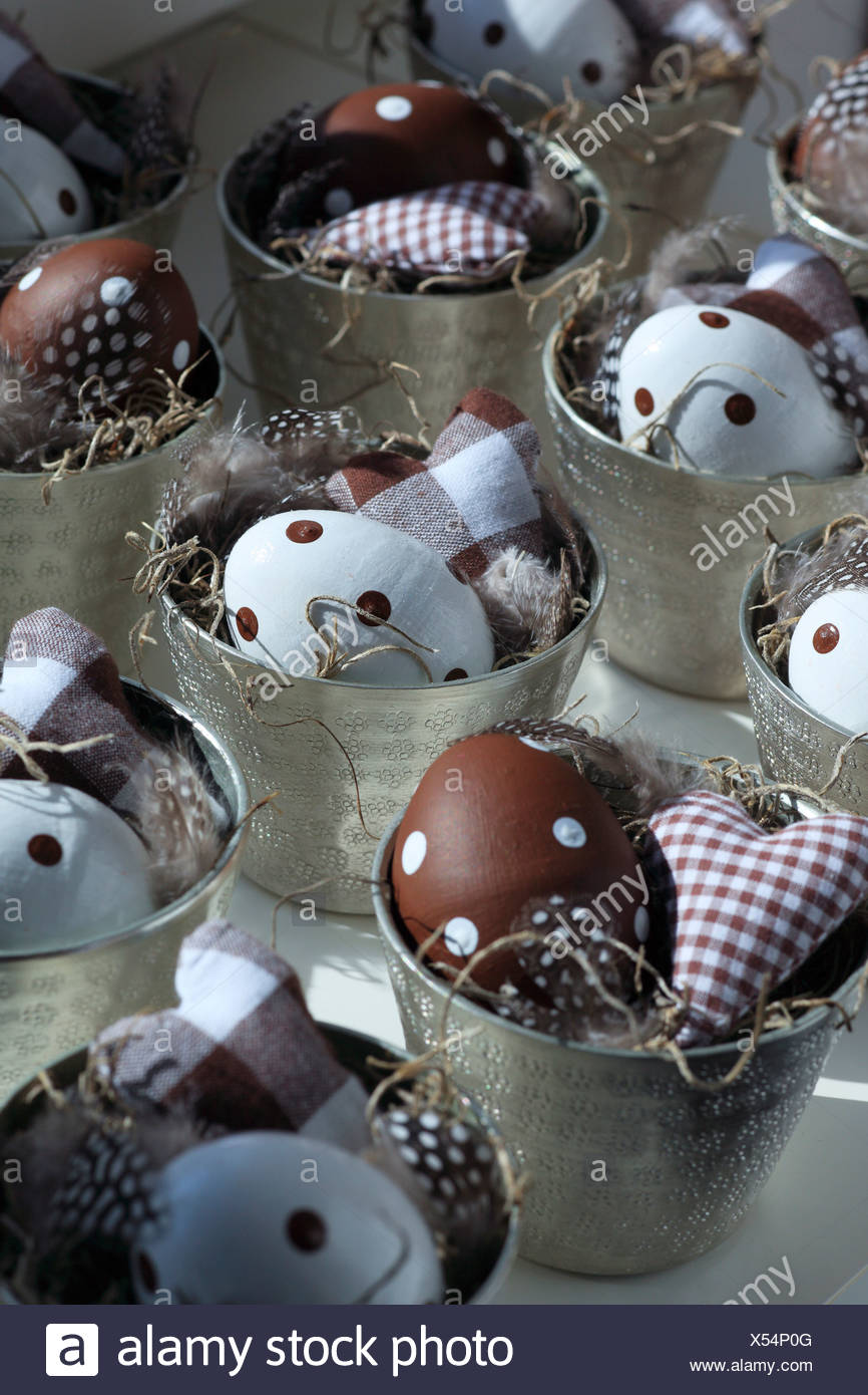 Mug, eggs, colors, feather, spring, feathers, springs, heart, hay, basket, macro, pattern, close-up, physical tones, Easter deco - Stock Image