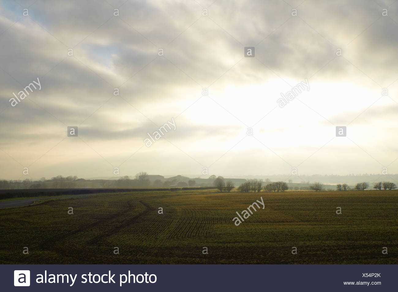 Cloudy sky over rural landscape - Stock Image