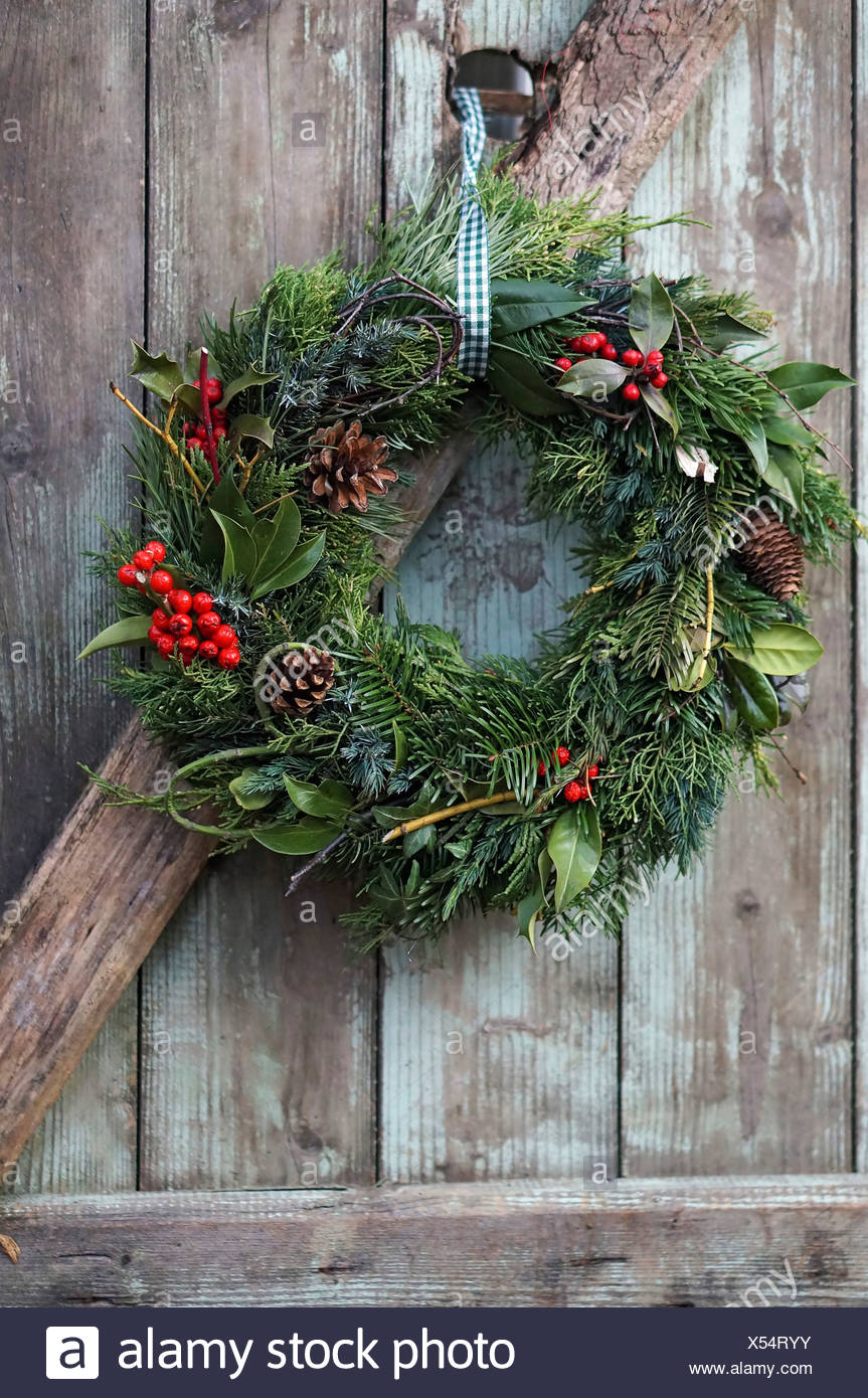 Christmas Wreath On Old Wooden Door Close Up Stock Photo 278545791