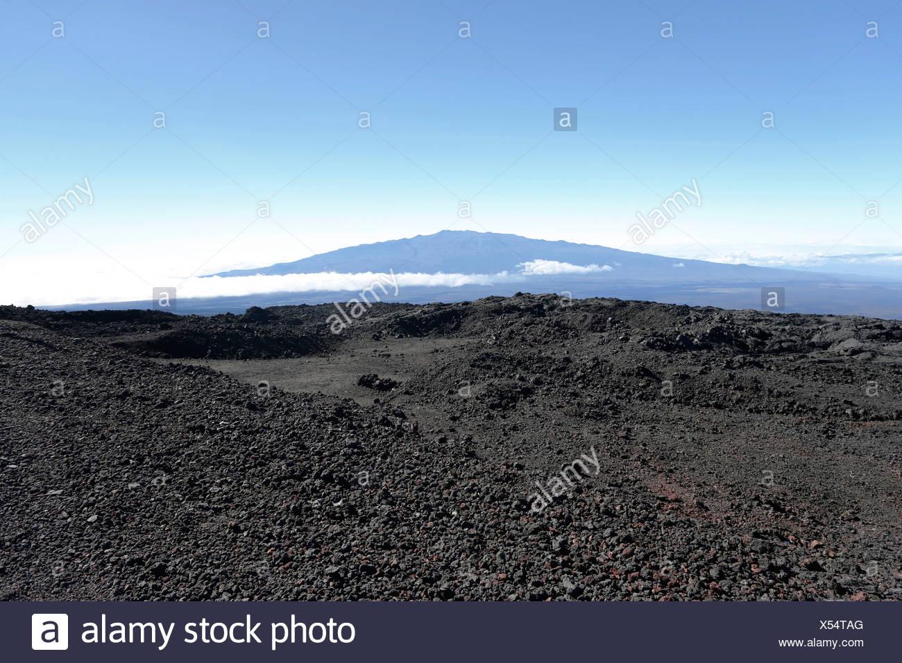 Summit of the Mauna Keo volcano with lava of the Mauna Loa volcano, Big Island, Hawaii, USA - Stock Image
