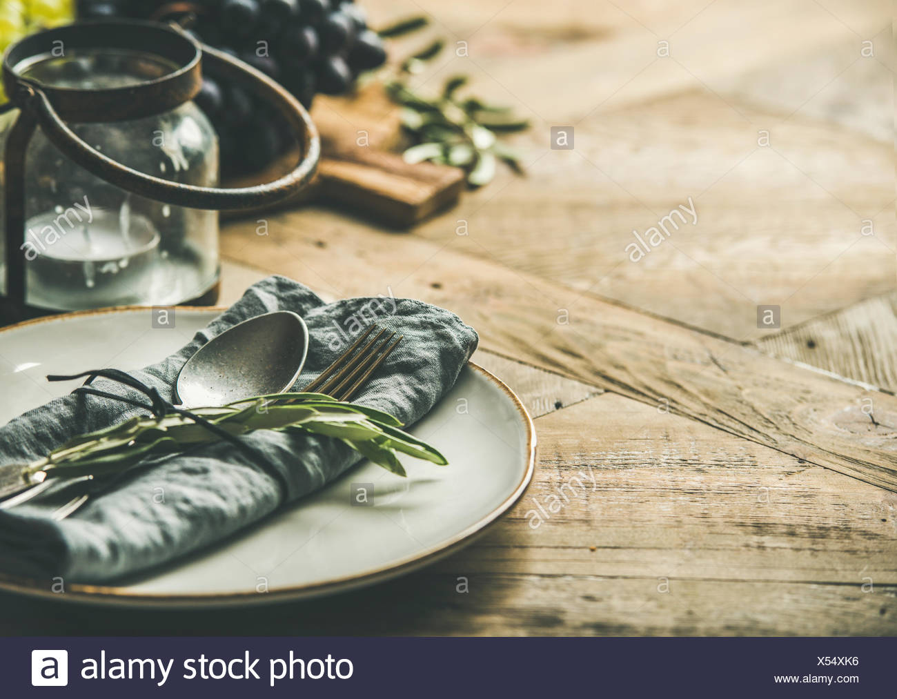 Fall Holiday Table Party Decoration Setting Plate With Linen Napkin Fork Spoon Candle Holder Grapes On Board Buns Olive Tree Branch Over Wooden Stock Photo Alamy