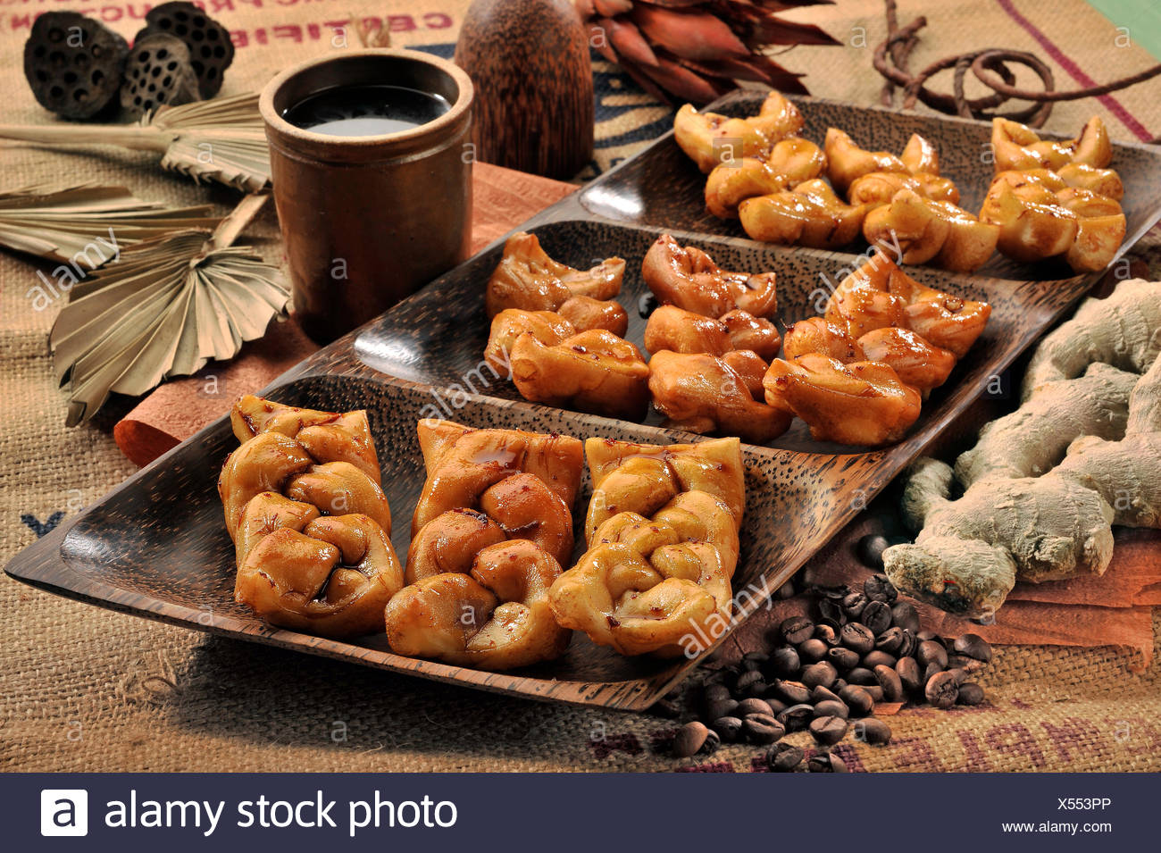 Sweet Braids with Coffee Sirup - Stock Image