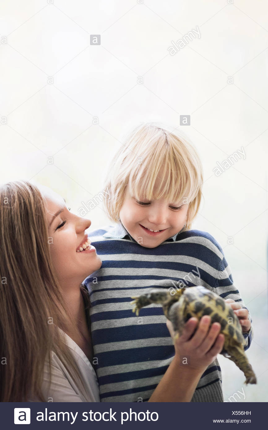 Family with turtle - Stock Image