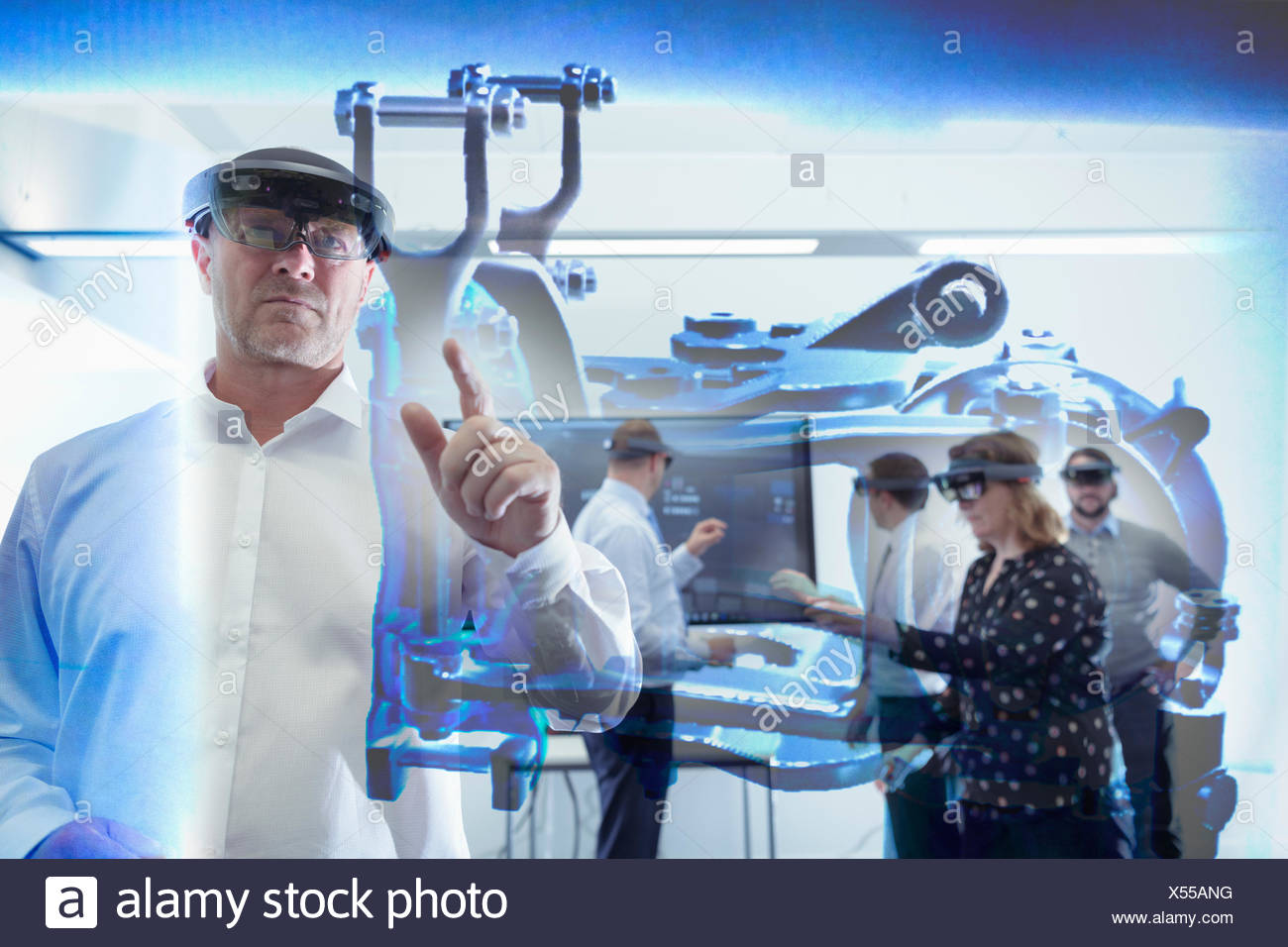 Engineers using Virtual Reality system in railway engineering facility - Stock Image