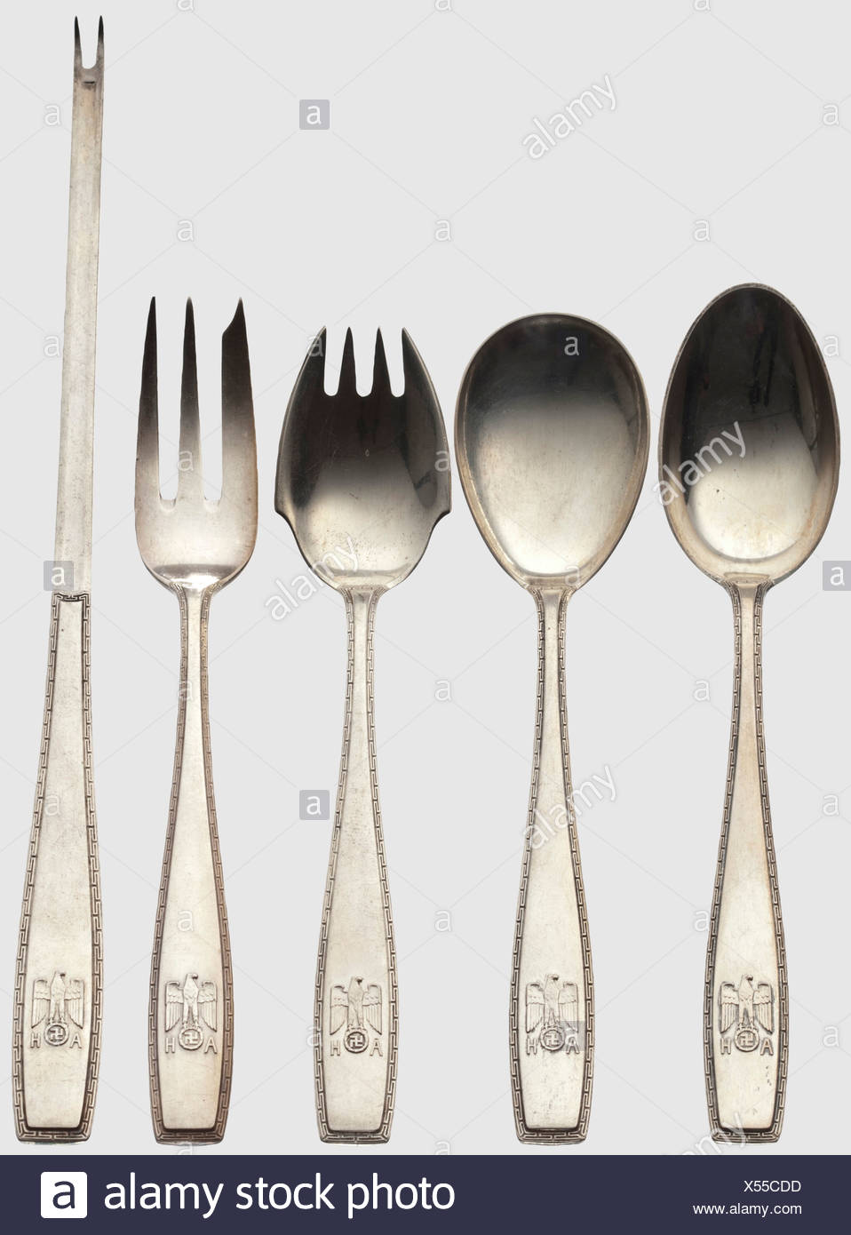 Adolf Hitler, five pieces from his personal silverware Lobster cracker, dessert and sugar spoons as well as cake and fruit forks. The grips each with a continous band of meander surrounding a national eagle in relief above the monogram 'AH'. Hallmarks '800' with a crescent moon and crown. Lengths between 14 and 20 cm, total weight 139 g. The lobster cracker in particular of the utmost rarity, historic, historical, 1930s, 1930s, 20th century, NS, National Socialism, Nazism, Third Reich, German Reich, Germany, German, National Socialist, Nazi, Nazi period, fascis, Additional-Rights-Clearences-NA - Stock Image