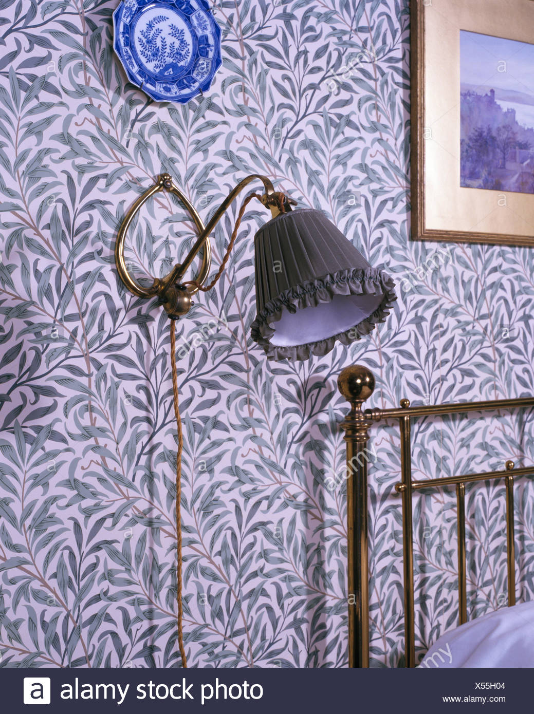 Close Up Of Lamp On Wall With William Morris Wallpaper In Victorian Style Bedroom Stock Photo Alamy