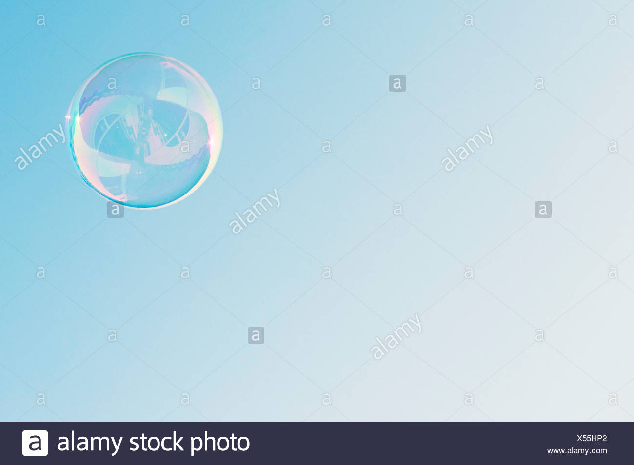 Low angle view of bubble against clear blue sky - Stock Image