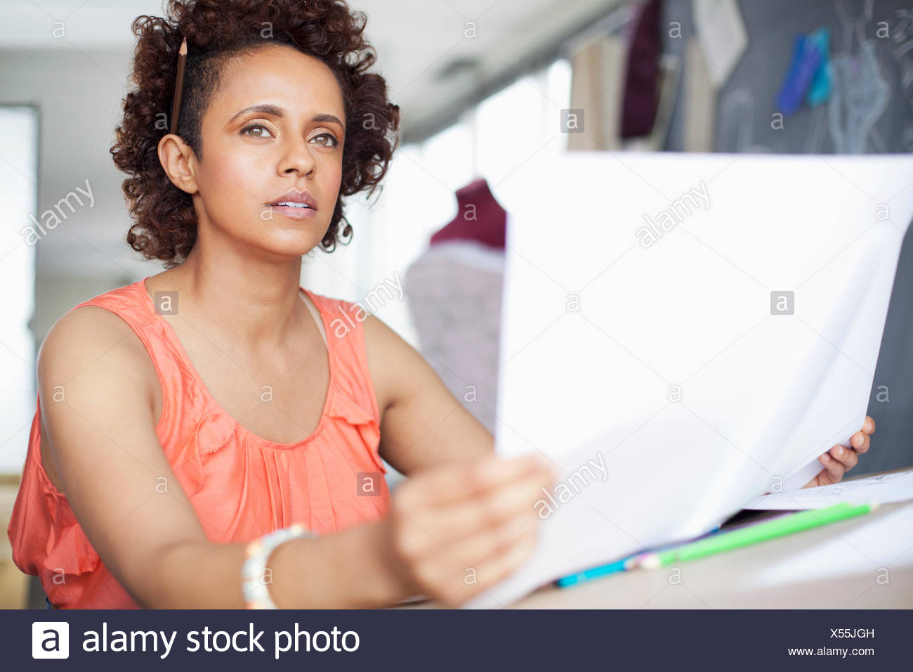 clothing designer dreaming of designs - Stock Image