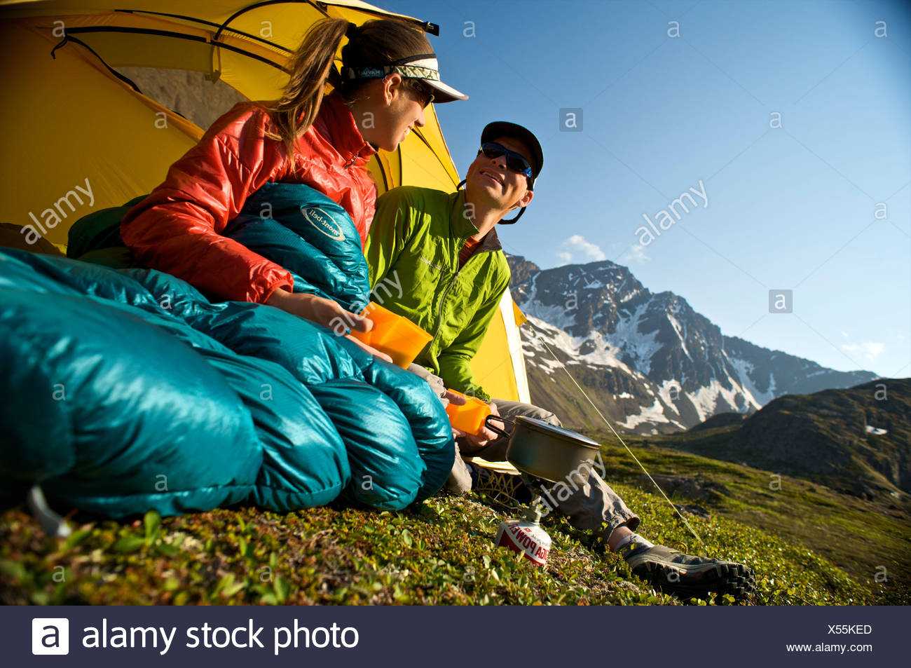Hikers enjoy a morning meal at camp on the Williwaw Lakes Trail in Chugach State Park near Anchorage,Southcentral Alaska, Summer - Stock Image