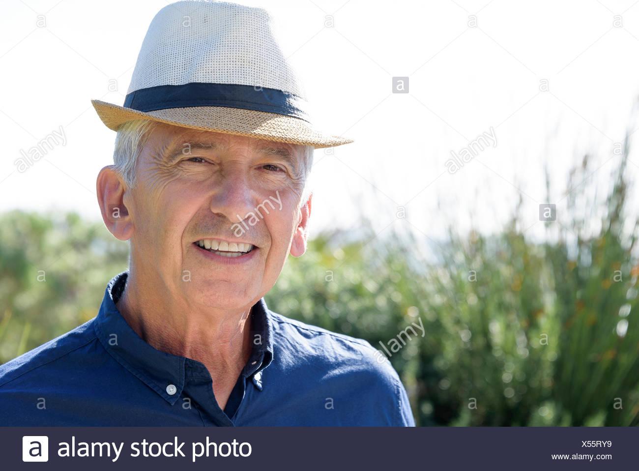Portrait of a happy senior man smiling - Stock Image