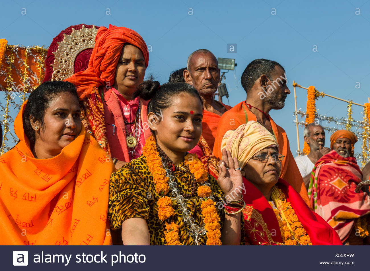 Group of sadhus, holy men, and sadhvis, holy women, participating in the procession of Shahi Snan, the royal bath - Stock Image
