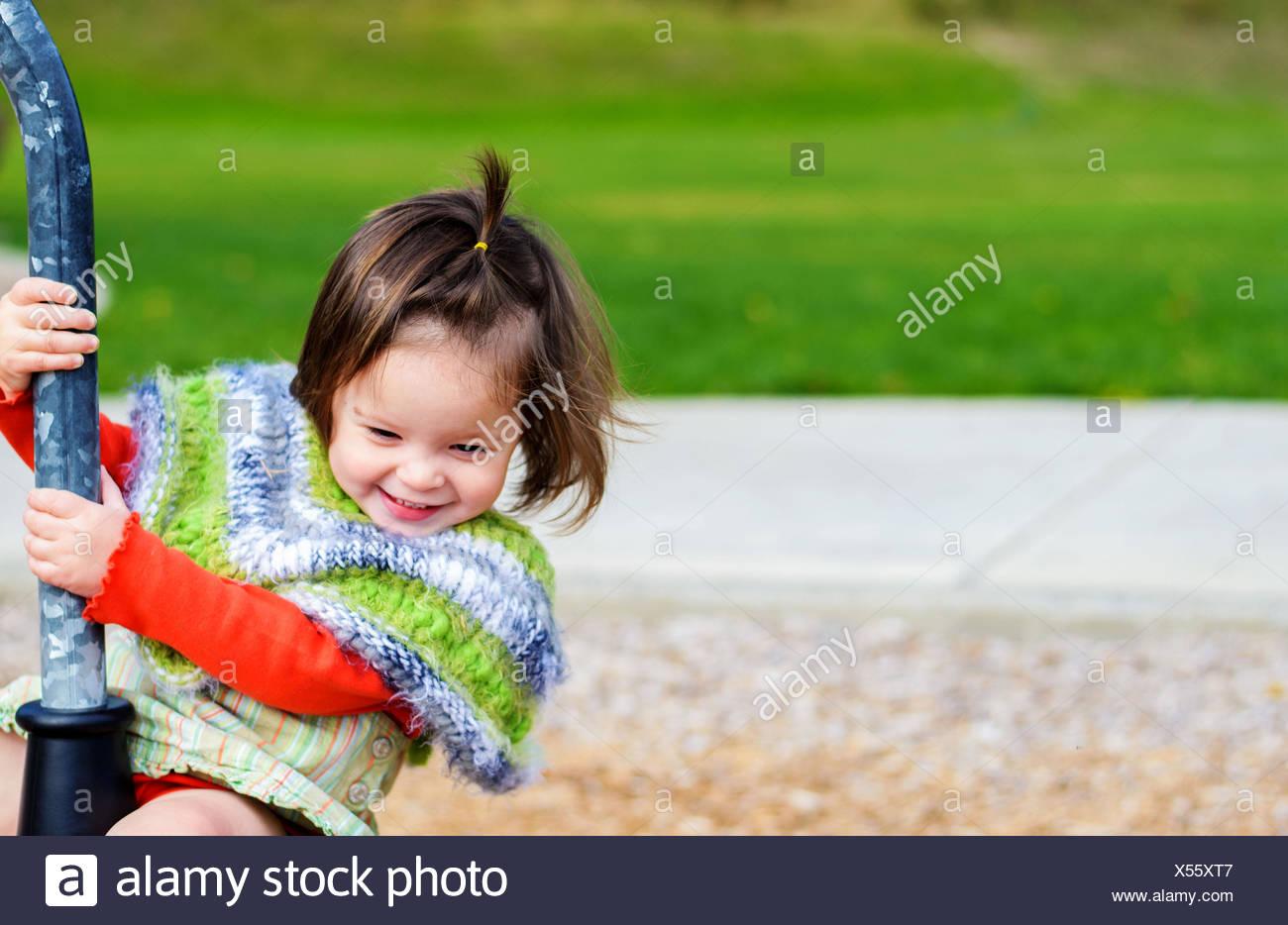 Girl at playground (2-3 years) - Stock Image