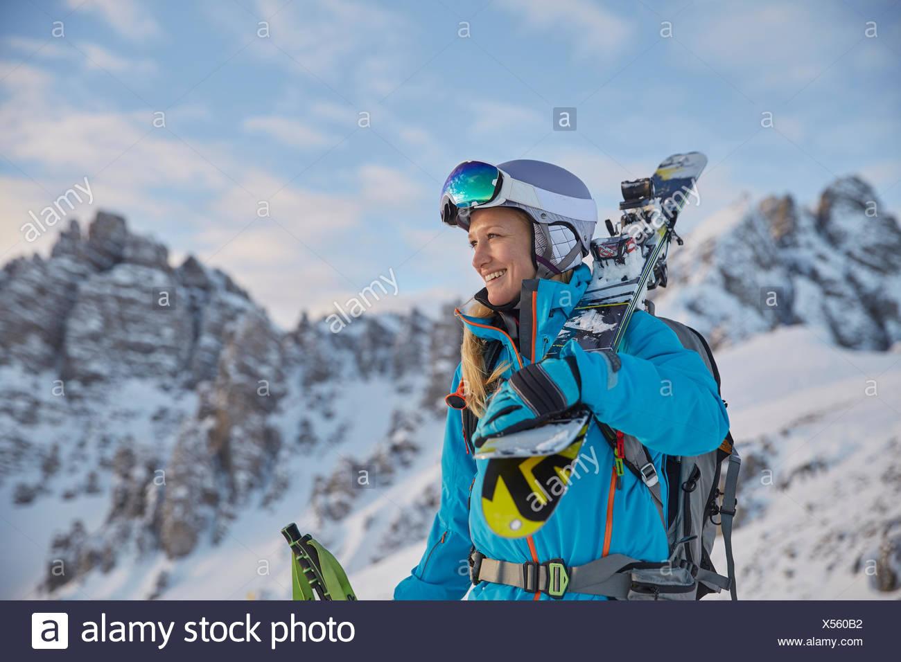 Skier, freerider with ski goggles and helmet, Kalkkögel behind, Axamer Lizum, Tyrol, Austria - Stock Image