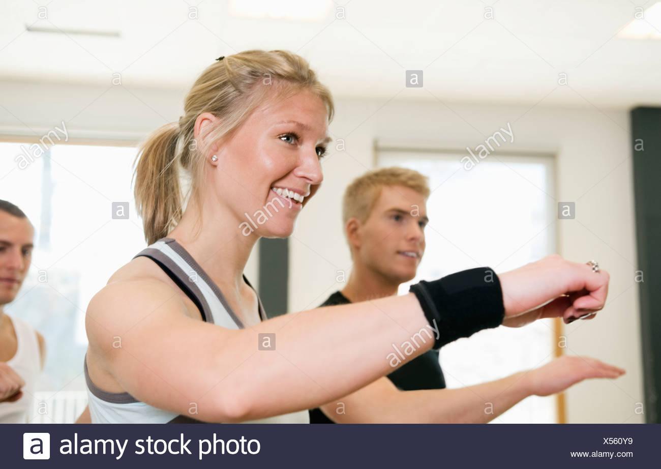 Three doing arm movements - Stock Image