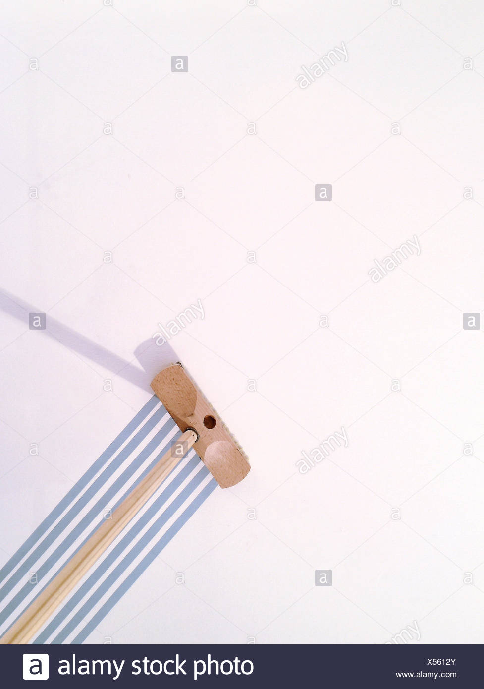 Low Angle View Of Broom By Lines On Wall At Home - Stock Image