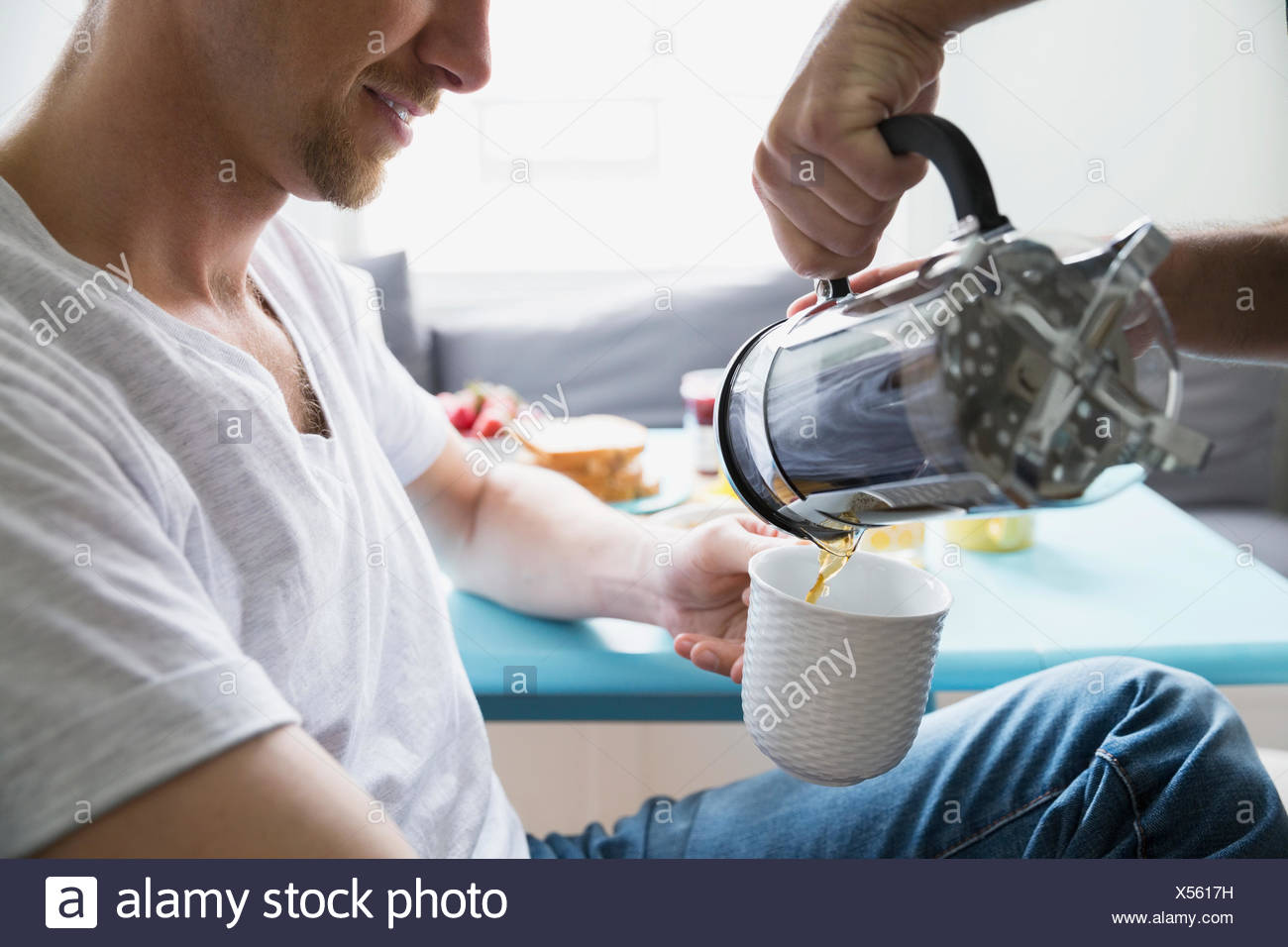 Man pouring French press coffee - Stock Image