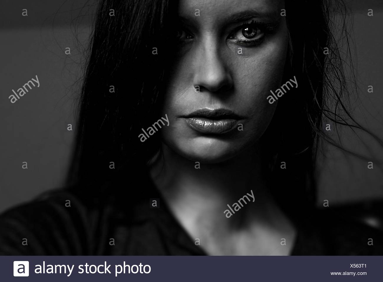 Close-Up Portrait Of Thoughtful Young Woman At Home - Stock Image