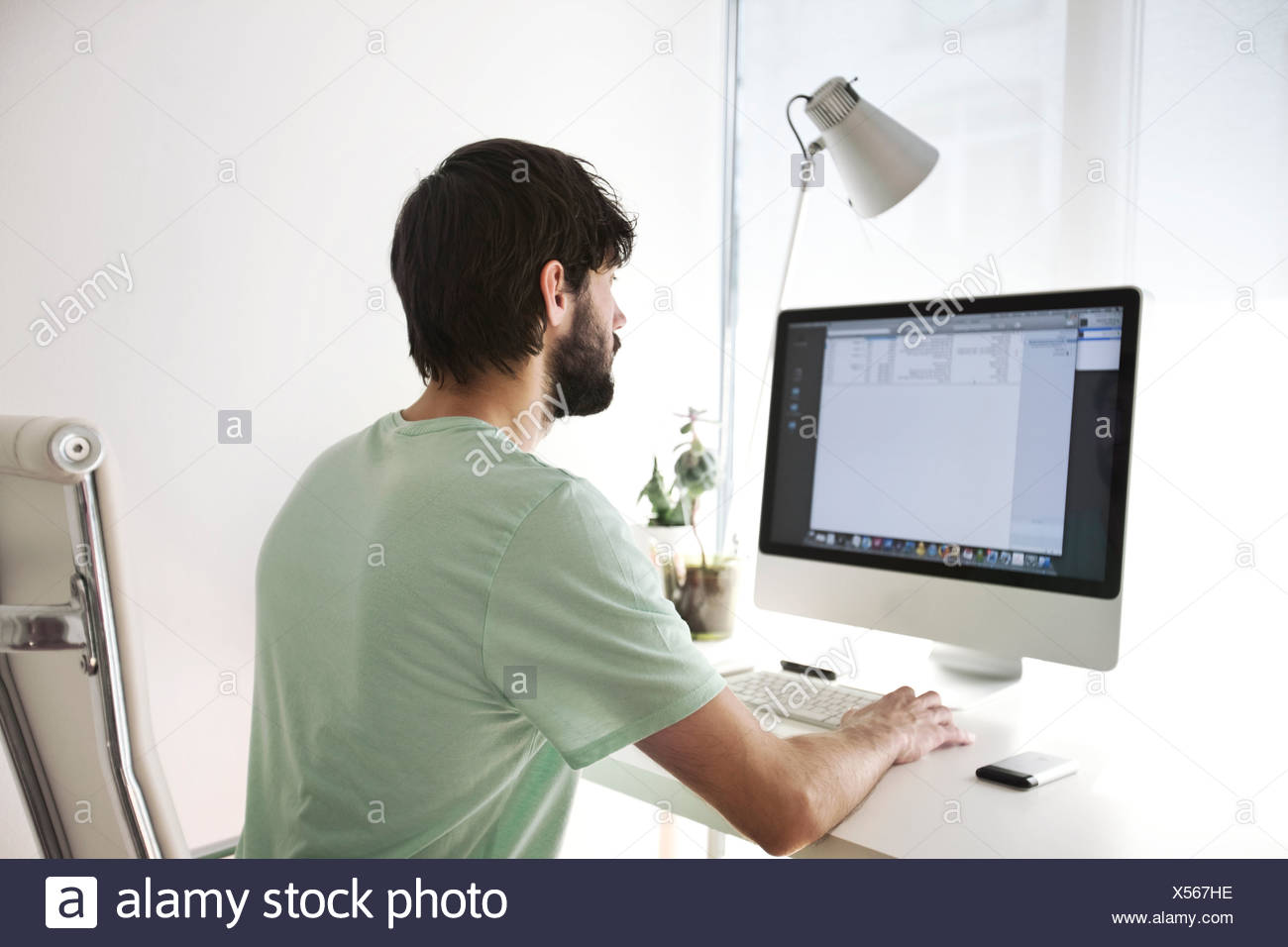 man working on the computer Stock Photo