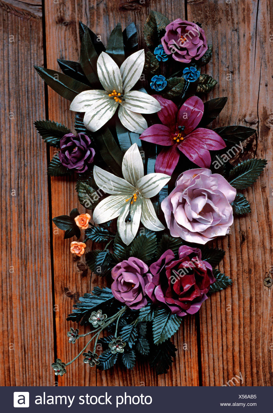 Bouquet of metal flowers attached to a wooden door Stock Photo ...