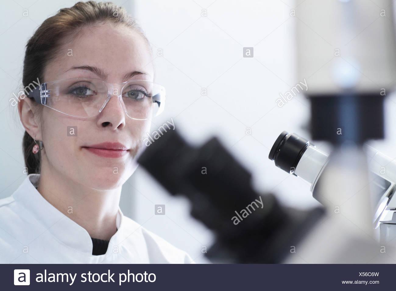 Close up portrait of female scientist in laboratory Stock Photo