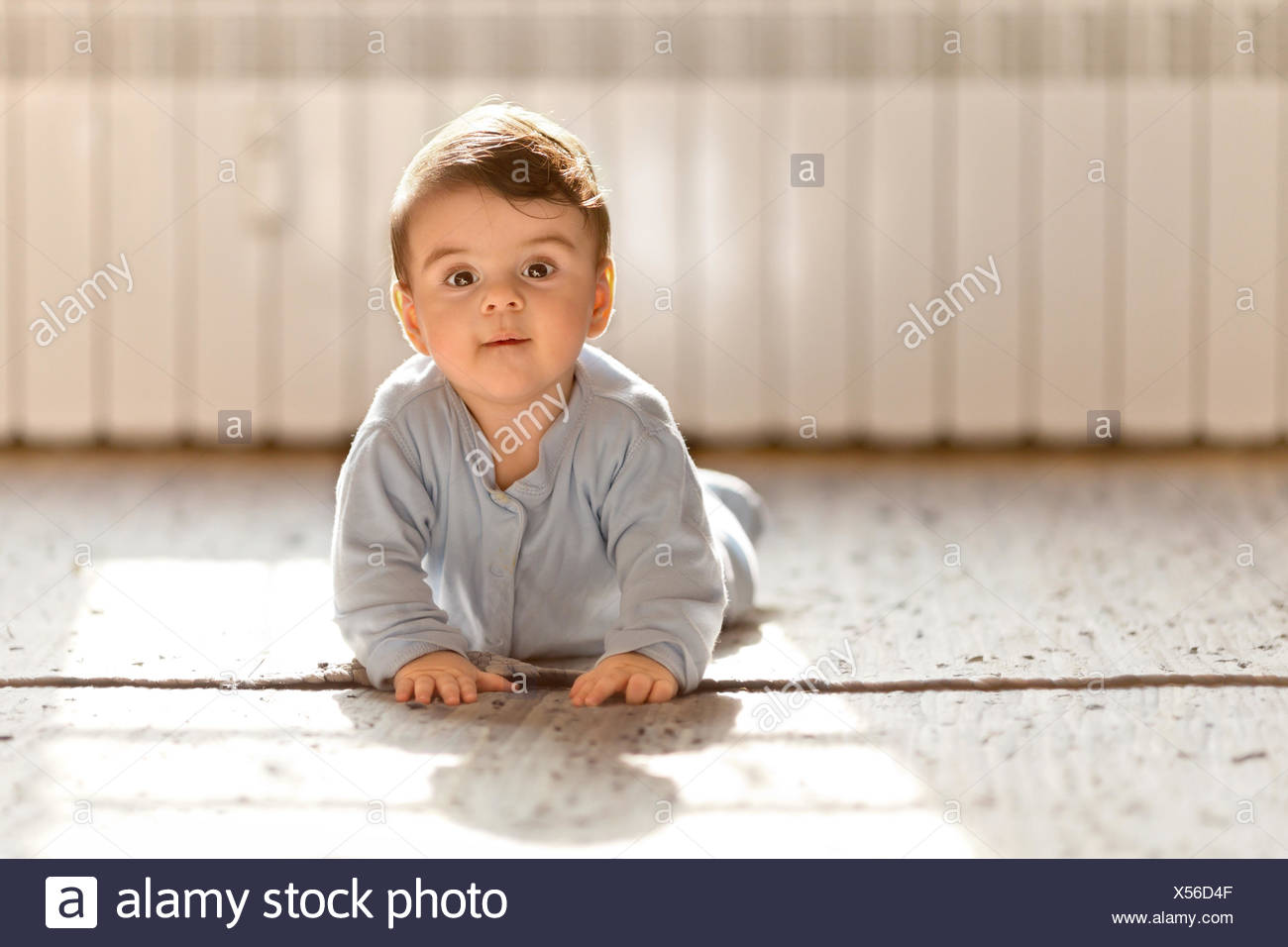 Baby boy looking at camera - Stock Image