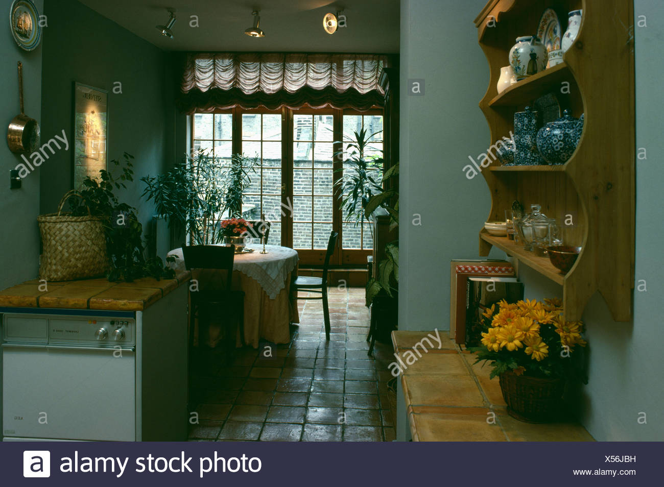 Pine Shelves On Wall Of Kitchen Diningroom Stock Photo 278585317