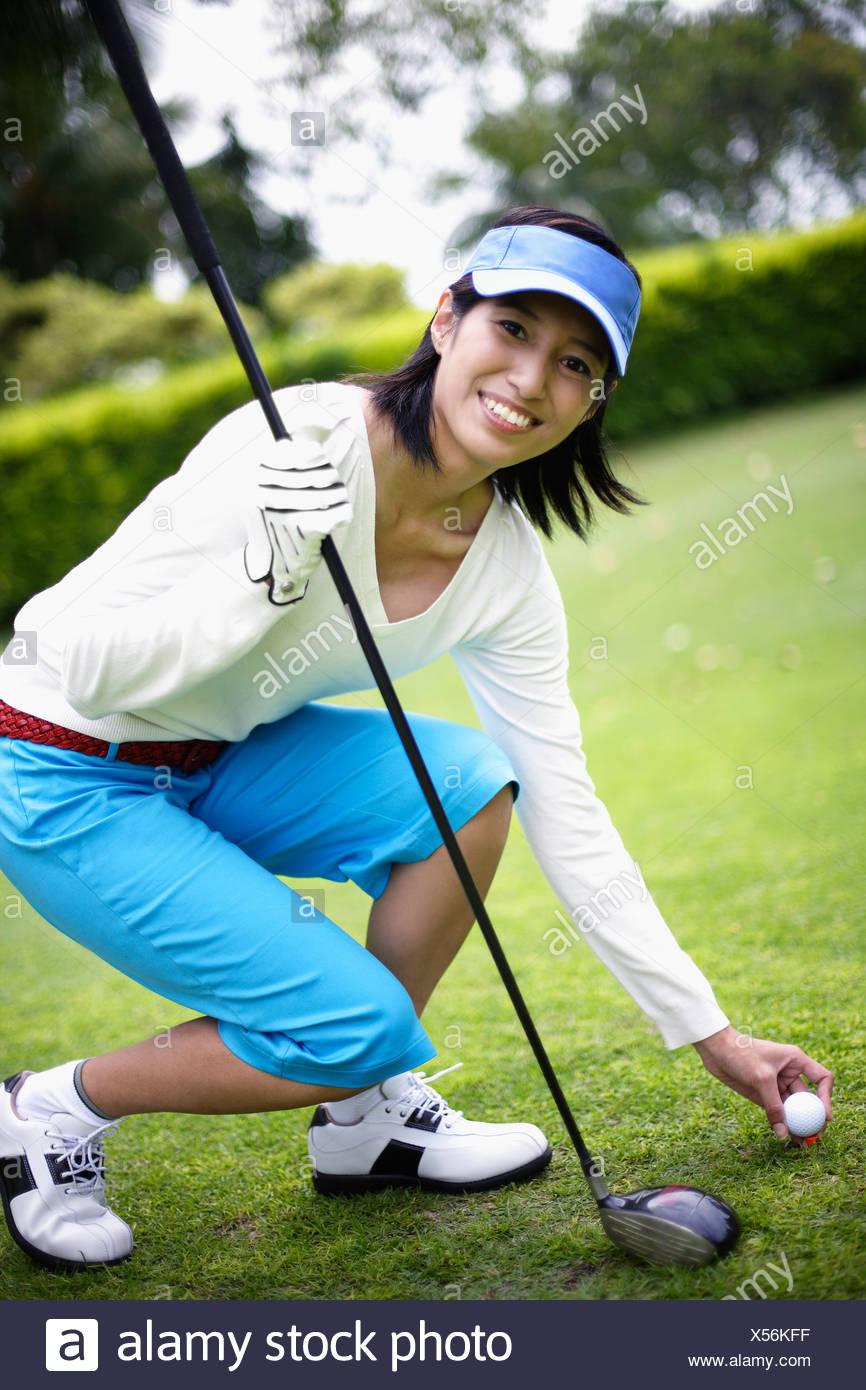 Woman playing golf - Stock Image