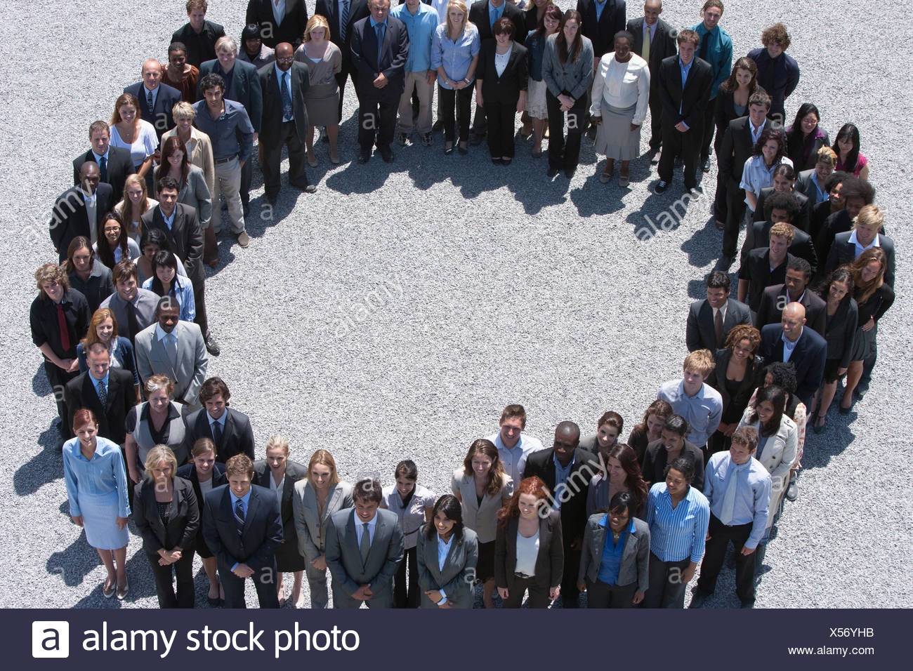 Portrait of smiling business people forming circle - Stock Image