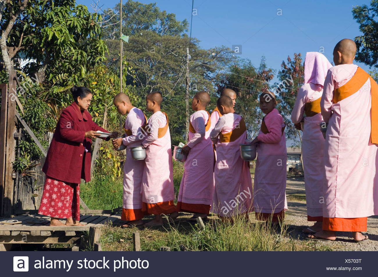 Young nuns begging, Inle Lake, Nyaungshwe, Shan State, Burma, Myanmar, Asia Stock Photo