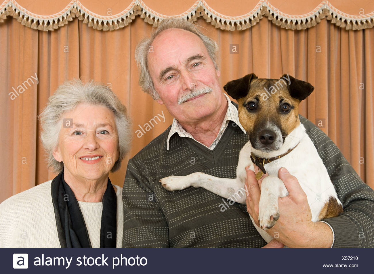 Couple with their pet dog - Stock Image