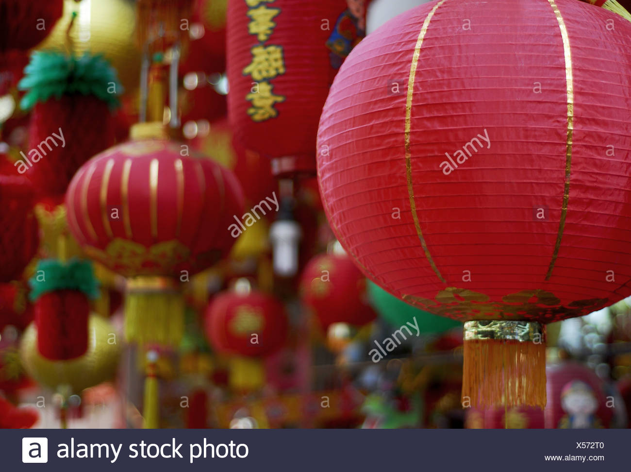 Lampions detail lanterns approximately cylindrically characters fringes red colorfully 03/2006 Asian Asia hung up illumination - Stock Image