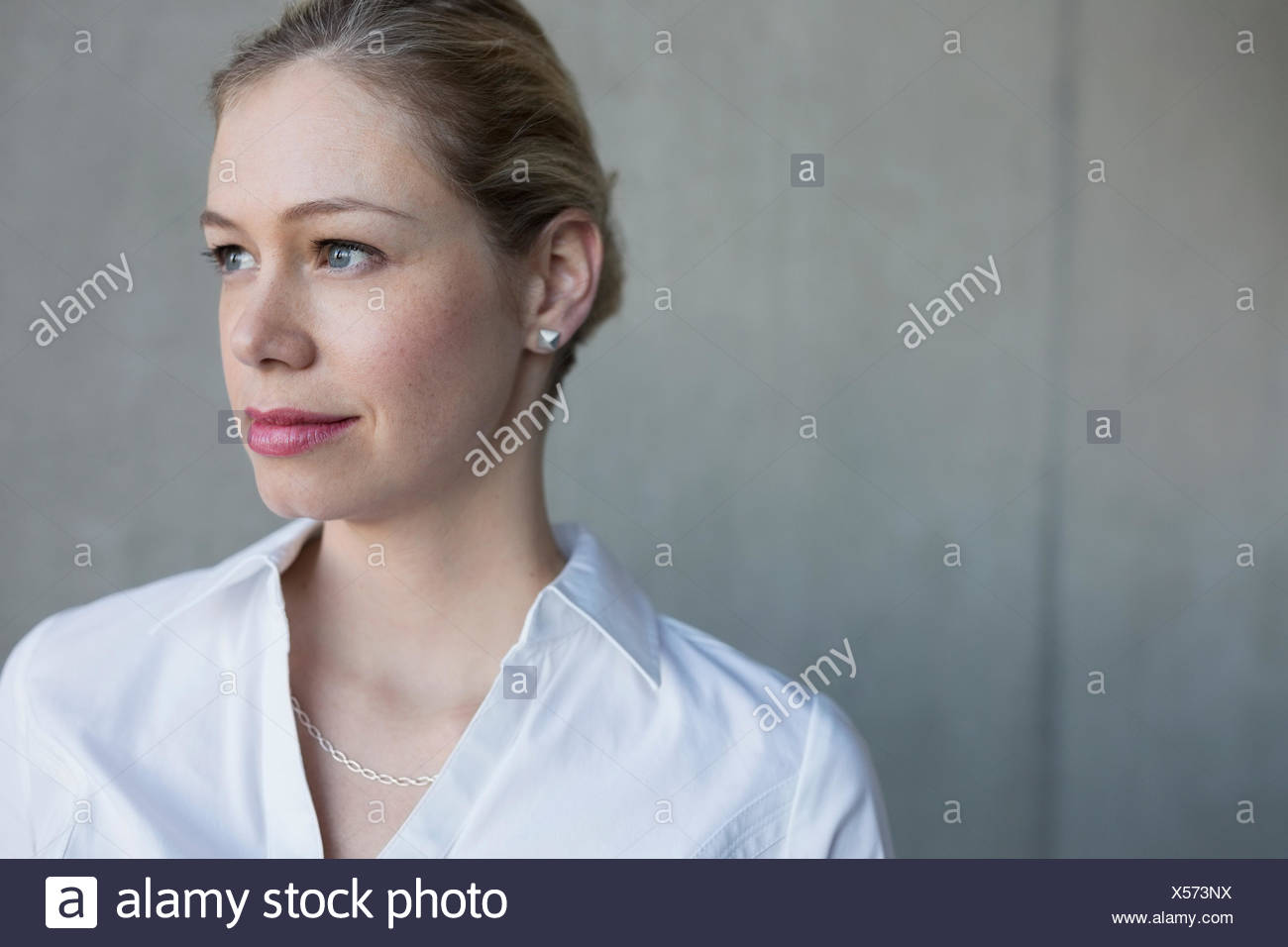Pensive businesswoman with blonde hair looking away Stock Photo