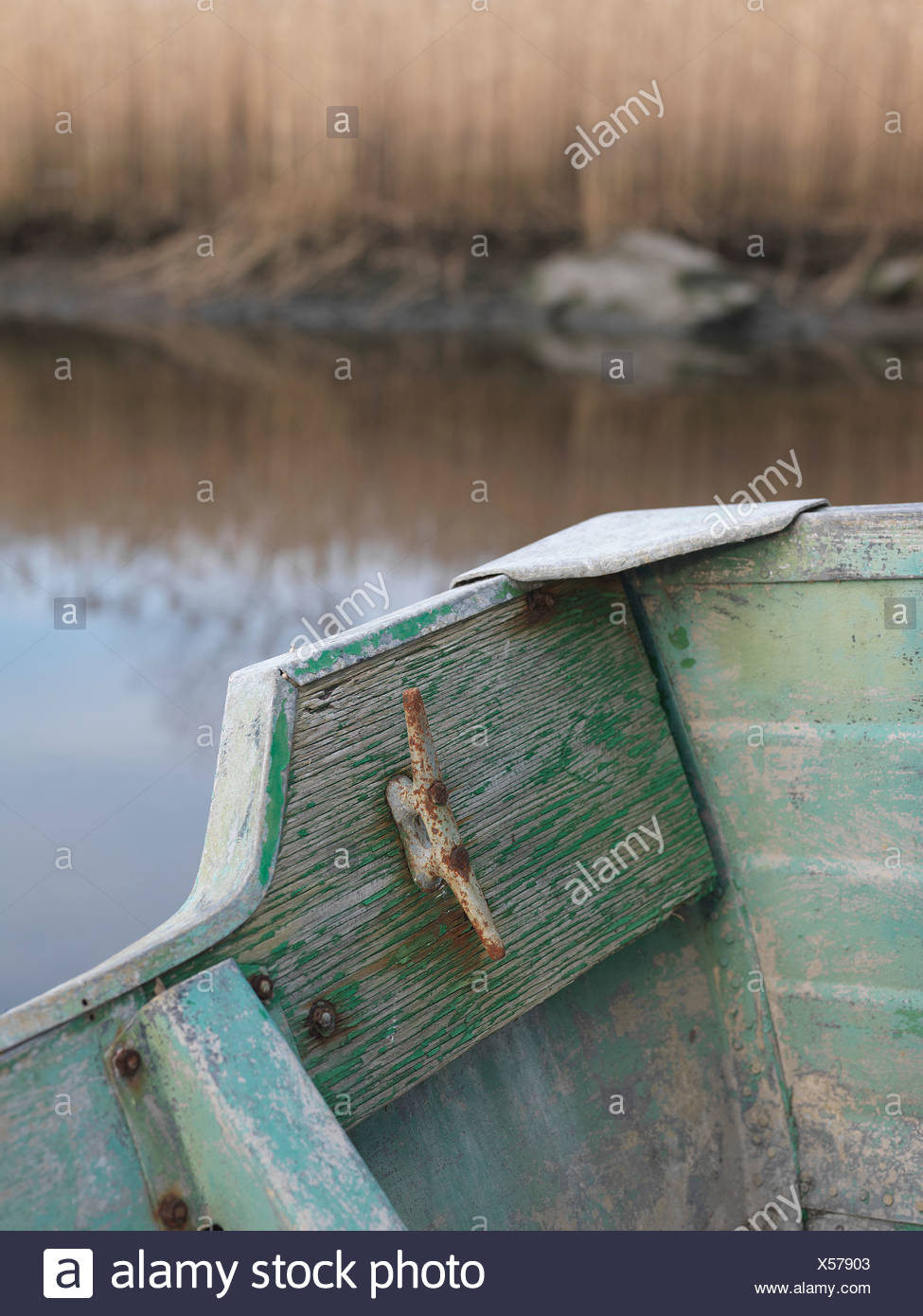 old, patina, flaking, paint, green, blue, rivets, boat, rowing, aluminum, edge, rear, rust, age, color, edge, rear, river, - Stock Image