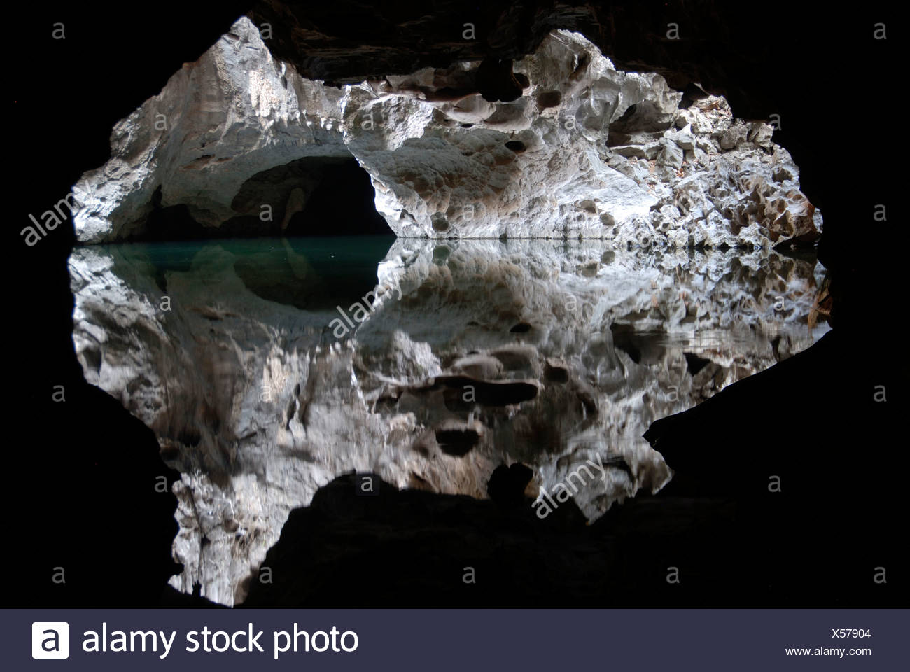 Potholing, speleology, quiet lake, reflection, water in the Tham Pha Incave in Thakek, Khammuan province, Khammouane, Laos - Stock Image