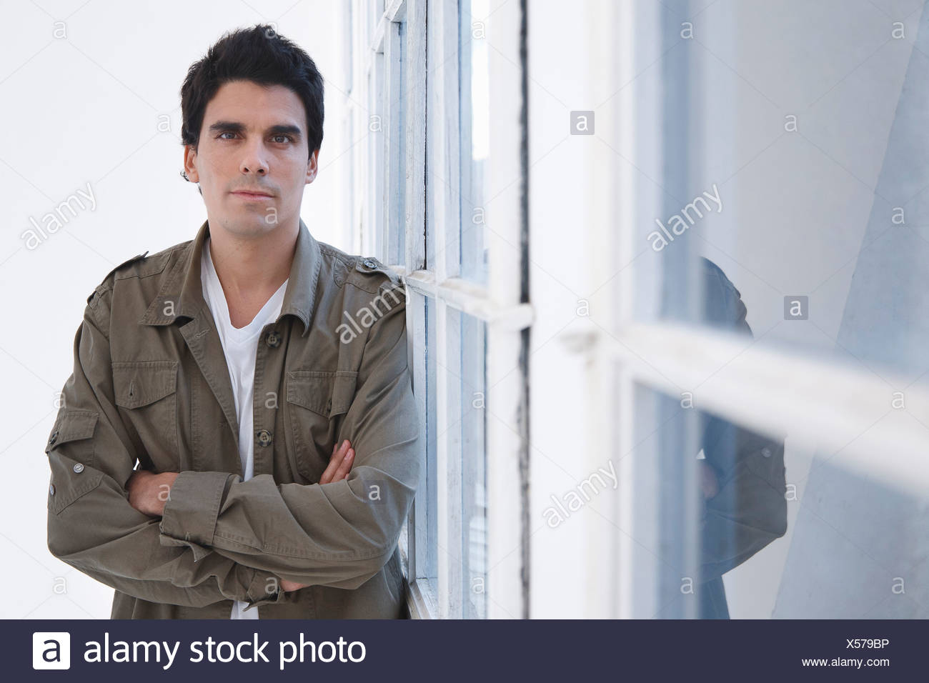 Portrait of a man, arms crossed - Stock Image