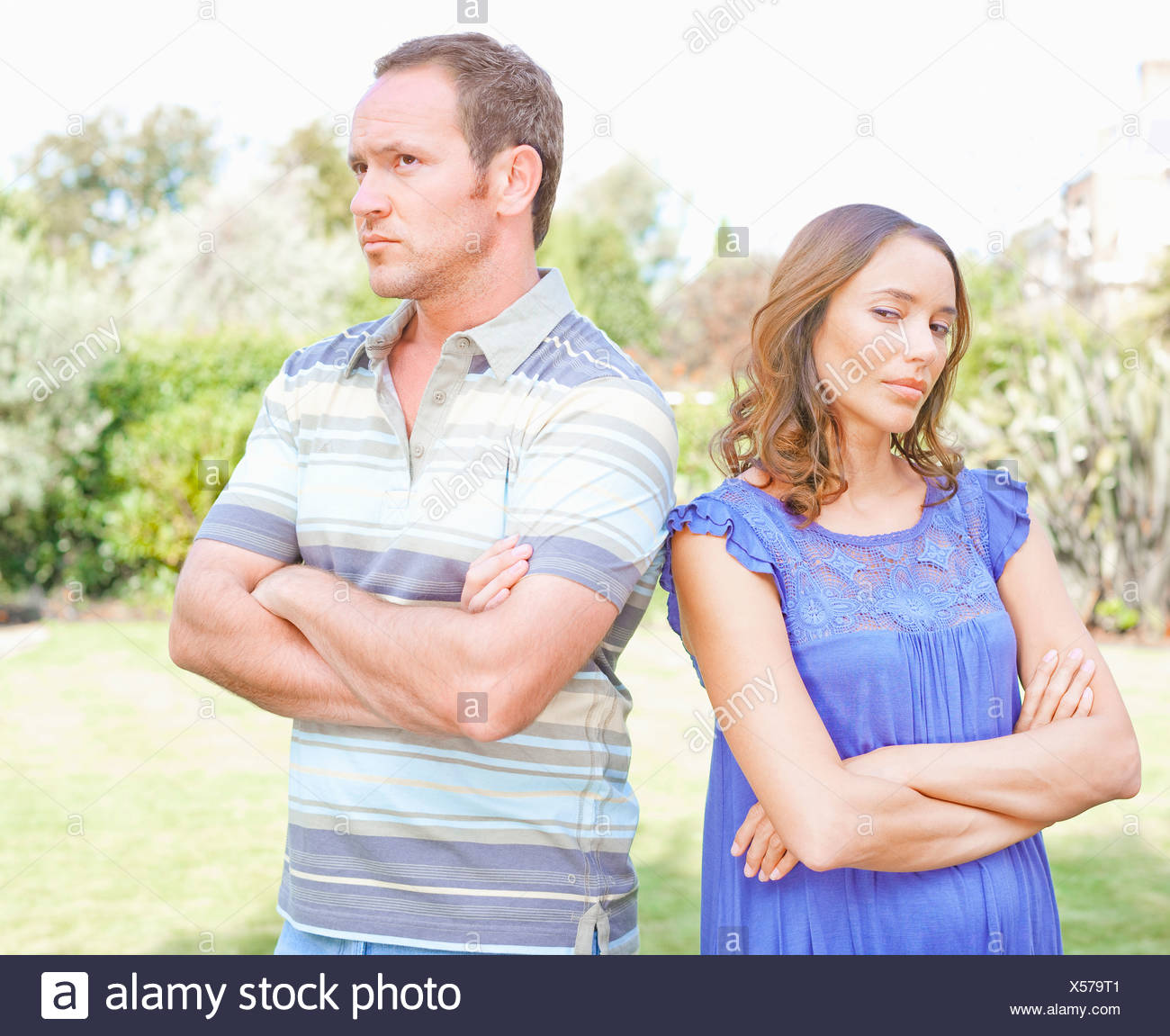 Arguing couple standing outdoors - Stock Image