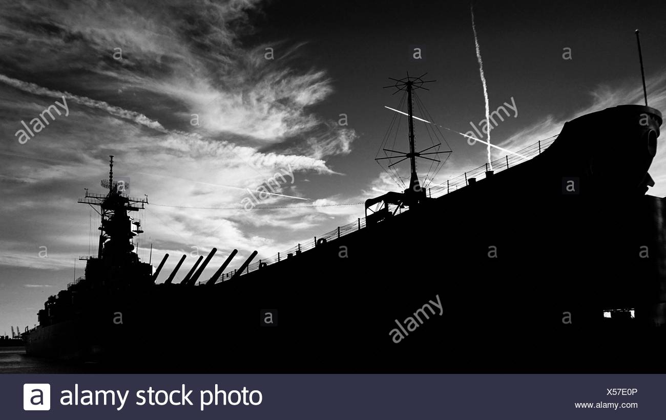 Low Angle View Of Silhouette Us Navy Ship Against Cloudy Sky - Stock Image
