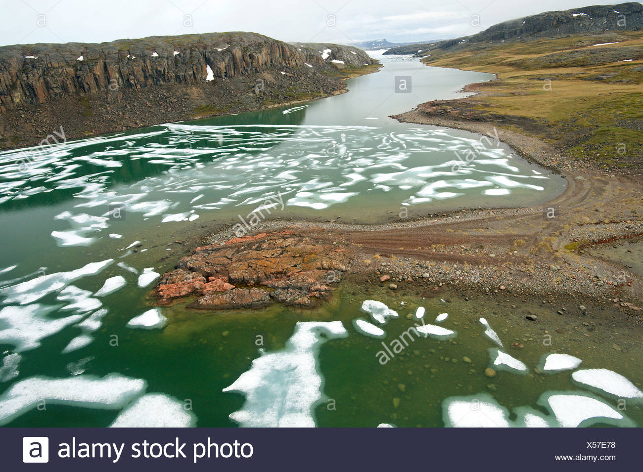 Melting ice in the Arctic Ocean with shoreline features, Coronation Gulf, Nunavut - Stock Image